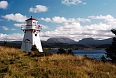 Woody Point Lighthouse looking over Bonne Bay toward Gros Morne mountain in the distance
