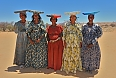 As we enter Damaraland, We may meet Herero women, who don distinctive attire harkening to Namibia\'s German colonial days. (photo: Tony Beck)