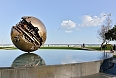 The Italian artist Arnaldo Pomodoro has left his golden sphere monuments all over the world. One of them has become the symbol of Pesaro in Le Marche.