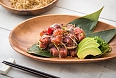 Poke is a raw fish salad served as an appetizer in Hawaiian cuisine, and sometimes as a main course. Traditional forms are aku and he'e.