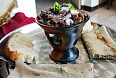Tibs, a meaty hybrid stir fry and stew which can very spicy. Served with bread, rice or, more properly, injera.