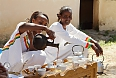 Women conducting a coffee ceremony